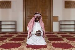 Arab Saudi Emirates Man Using A Smart Touchpad Stock Photo
