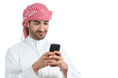 Arab saudi man watching social media in the smart phone. Isolated on a white background Royalty Free Stock Photography