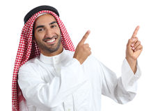 Arab saudi presenter man presenting pointing at side. Isolated on a white background Stock Image