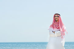 Arab on seaside in traditional clothing Stock Photography