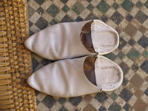 Arab shoes. Traditional arab shoes, left outside a mosque (it''s forbidden to enter a mosque with shoes on). The floor is also typical Stock Images