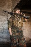 The Arab soldier with the AK-47 Kalashnikov assault rifle. Portrait of serious middle eastern man with AK-47 Royalty Free Stock Photos