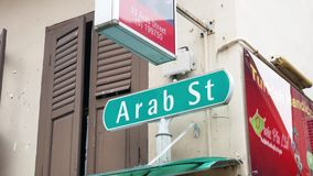 Arab Street Name Sign in Singapore. To easy find the gorgeous Masjid Sultan Mosque, the area is filled with indie boutiques, street arts, restaurants and bars stock footage