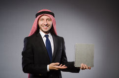 Arab student with book Royalty Free Stock Photos