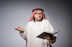 Arab student with book. In education concept Stock Images