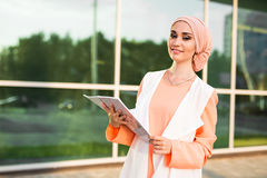 Arab Student holding a folder. Young beautiful Arab Student holding a folder royalty free stock photo