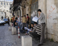 Arab Students Studying for Exams. JERUSALEM, ISRAEL – JUNE 12: Group of young, male, Arab students stand inside the New Gate on Bab El-Jadid Street in Old City Stock Photography