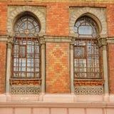 Arab-style windows. Old terracotta brick wall with Moorish style windows of the Hydropathic Treatment Center, Mykolaiv City, Ukraine Stock Photo