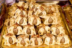 Arab sweet pastries cakes stacked bakery. With nuts Royalty Free Stock Photos