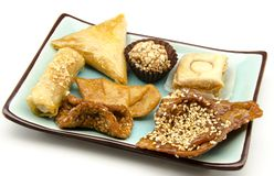 Arab sweets. Stacked alongside other surrounded by white backgound Royalty Free Stock Photos