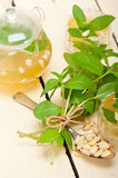 Arab traditional mint and pine nuts tea Stock Photo
