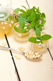 Arab traditional mint and pine nuts tea stock photos