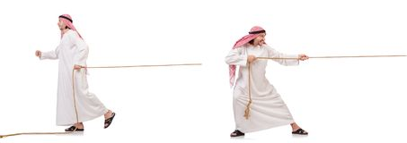 The arab in tug of war concept on white. Arab in tug of war concept on white Royalty Free Stock Photo
