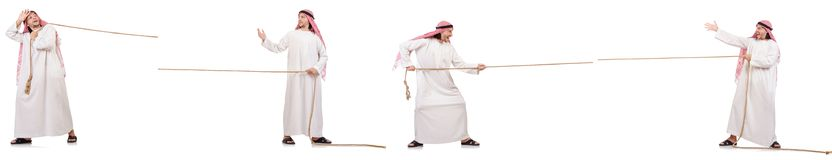 The arab in tug of war concept on white. Arab in tug of war concept on white Royalty Free Stock Image