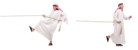 The arab in tug of war concept on white Royalty Free Stock Images