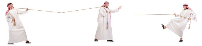 The arab in tug of war concept on white Stock Photos