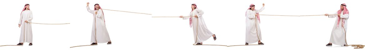 The arab in tug of war concept on white Stock Photo