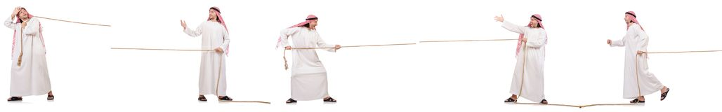 The arab in tug of war concept on white. Arab in tug of war concept on white Royalty Free Stock Photography