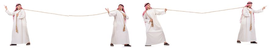 The arab in tug of war concept on white. Arab in tug of war concept on white Royalty Free Stock Images