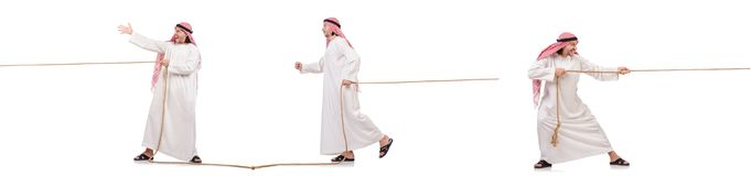 The arab in tug of war concept on white. Arab in tug of war concept on white Royalty Free Stock Photos