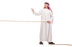 Arab in tug of war concept. On white Stock Image