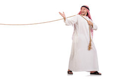 Arab in tug of war concept. On white Royalty Free Stock Images
