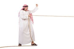 Arab in tug of war concept. On white Stock Photo