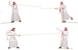 The arab in tug of war concept on white. Arab in tug of war concept on white Stock Images