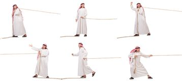 The arab in tug of war concept on white. Arab in tug of war concept on white Stock Photo