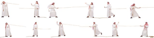 The arab in tug of war concept on white. Arab in tug of war concept on white Stock Image