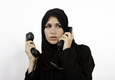 An Arab Woman Answers The Phone Stock Image