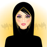 Arab woman in the desert Royalty Free Stock Photos