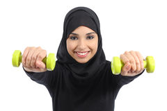 Arab woman doing weights fitness concept. Isolated on a white background stock images