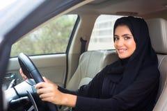 Arab Woman driving. Beautiful Arab Woman driving car royalty free stock images