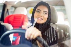 Arab Woman driving. Beautiful Arab Woman driving car Royalty Free Stock Image