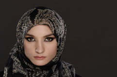 Arab woman on a gray background Stock Photography