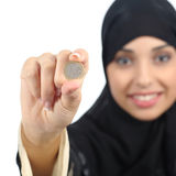 Arab woman holding and showing an euro coin Stock Photos