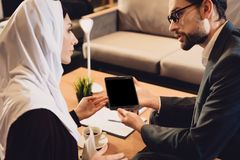Arab woman at reception with psychologist stock image