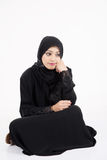 Arab woman Sitting on the floor Royalty Free Stock Photo