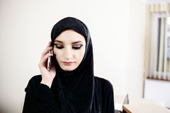 Arab woman while talking on cell phone. Arab woman while talking on a cell phone in the office Stock Images