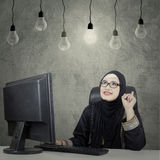 Arab woman thinking of idea under bulb Royalty Free Stock Photography