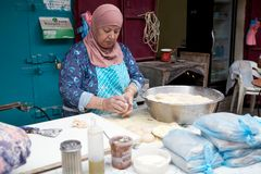 Arab woman. With traditional clothes are making local food at the Akko suq, Israel Royalty Free Stock Photography