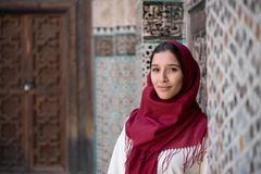 Arab woman in traditional clothing with red hijab. On her head Stock Photos