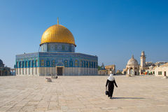 Arab woman with veil walking towards Dome of the Rock Royalty Free Stock Image