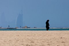 Arab woman walking on the beach Royalty Free Stock Images