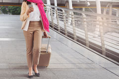 Arab woman walking carrying a suitcase Royalty Free Stock Photo