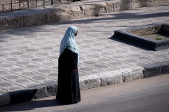 Arab woman walking in the street Stock Photos