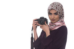 Arab Woman Wearing A Hijab Taking A Photography. Arab Woman Photographer Holding A Dslr Camera Isolated On A White Background Royalty Free Stock Photo