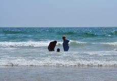 Arab women into ocean Stock Photo