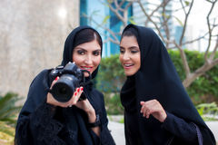 Arab Women Photography. Arab Women viewing photos on camera Stock Images